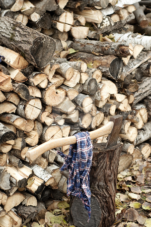 Chopped Wood stock photo, A pile of chopped wood with an axe stuck in a stump by Richard Nelson