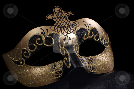 Venetian Mask On Black stock photo, An intricate venetian mask, shot against a black background by Richard Nelson