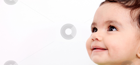 Baby face smiling stock photo, Baby face smiling over white background. Horizontal composition with space to insert text or design by Giuseppe Ramos