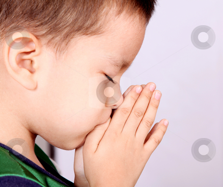 Child stock photo, Child pray over white background. Beauty image by Giuseppe Ramos