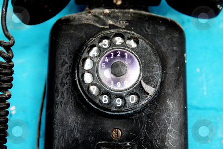 Phone stock photo, Old telephone over blue background. Retro object by Giuseppe Ramos