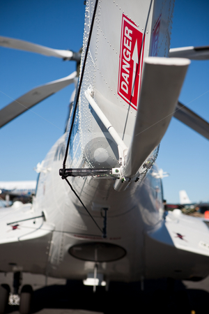 Tail sign stock photo, Red dnger sign on the tail of a white helicopter fuselage by Ian Genis