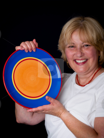 Mature Woman with colorful plate stock photo, Mature Woman by Jim DeLillo