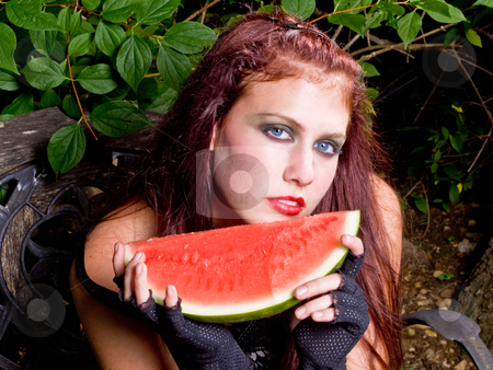 Gothic girl eating watermelon stock photo, Rachel by Jim DeLillo