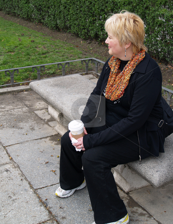 Mature Woman on park bench stock photo, Mature Woman by Jim DeLillo