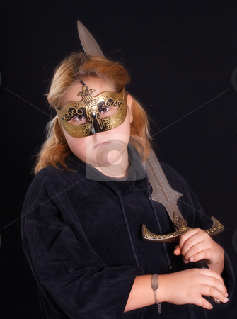 Warrior Princess stock photo, A mythical warrior princess holding her sword and wearing her mask, shot against a black background by Richard Nelson