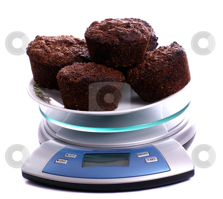 Bran Muffins stock photo, A plate of bran muffins on a small scale, isolated against a white background by Richard Nelson