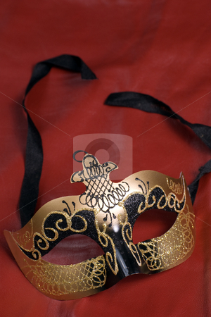 Theater Mask stock photo, A venetian mask commonly used in theatrical plays shot on red by Richard Nelson