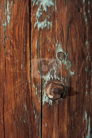 Weathered wood of old barn post stock photo, Weathered wood of old barn post with knots, rusty bolt and traces of green paint by Marek Uliasz