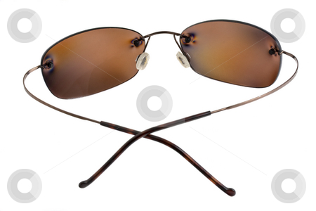 Polarizing sunglasses with brown lenses stock photo, Sunglasses with brown polarizing lenses isolated on white by Marek Uliasz