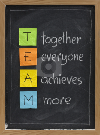 Teamwork concept on blackboard stock photo, TEAM acronym (together everyone achieves more), teamwork motivation concept, color sticky notes, white chalk handwriting on blackboard by Marek Uliasz