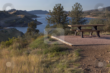 Picnic table on shore of mountain reservoir stock photo, Picnic table on shore of mountain lake (Horsetooth Reservoir) near Fort Collins, Colorado at foothills of Rocky Mountains, early morning, fall scenery by Marek Uliasz