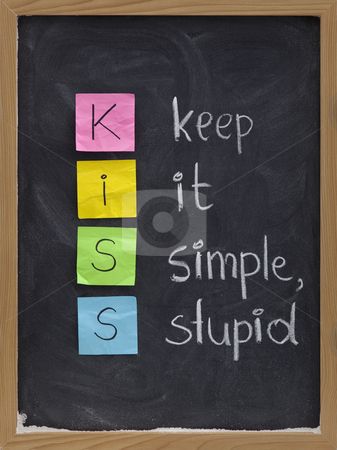 Keep it simple, stupid - KISS principle stock photo, KISS keep it simple, stupid - design principle presented with sticky notes and white chalk handwriting on blackboard by Marek Uliasz