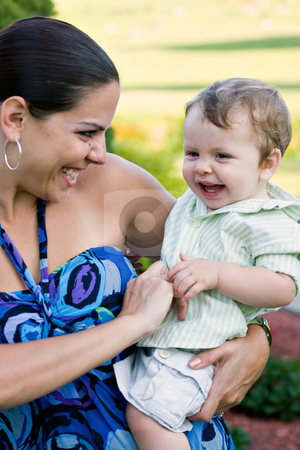 Happy Mother Holding Her Baby stock photo, A young mother tickles her baby happily. by Todd Arena