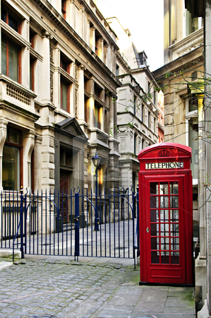Telephone box in London stock photo, Red telephone box near old buildings in London by Elena Elisseeva