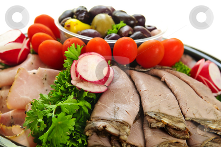 Cold cut platter stock photo, Platter of assorted cold cut meat slices by Elena Elisseeva