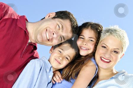 Happy family portrait stock photo, Portrait of happy family of four smiling by Elena Elisseeva