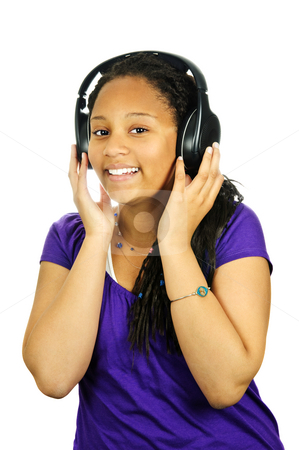 Teenage girl stock photo, Isolated portrait of black teenage girl listening to headphones by Elena Elisseeva