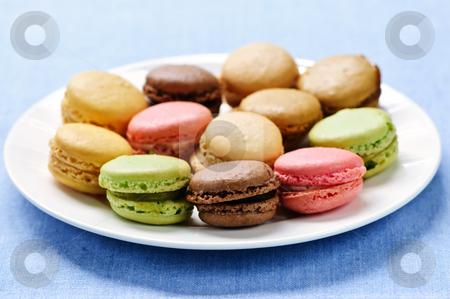 Macaroon cookies stock photo, Fresh multicolored macaroon cookies served on a plate by Elena Elisseeva