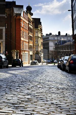 London street stock photo, Cobblestone paved street in London on sunny day by Elena Elisseeva