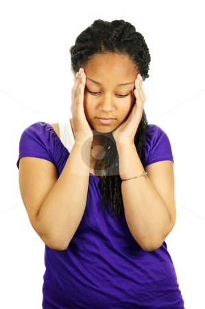 Teenage girl stock photo, Isolated portrait of worried teenage girl with headache by Elena Elisseeva