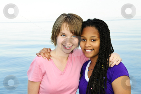Happy teenage girlfriends stock photo, Portrait of two happy teenage girl friends by Elena Elisseeva