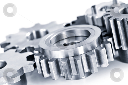 Gears stock photo, Interlocking industrial metal gears isolated on white by Elena Elisseeva