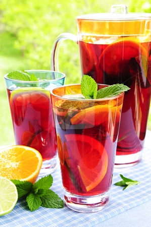 Fruit punch in pitcher and glasses stock photo, Refreshing fruit punch beverage in pitcher and glasses by Elena Elisseeva