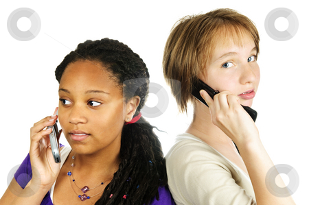 Teen girls with mobile phones stock photo, Isolated portrait of two teenage girls with cell phones by Elena Elisseeva