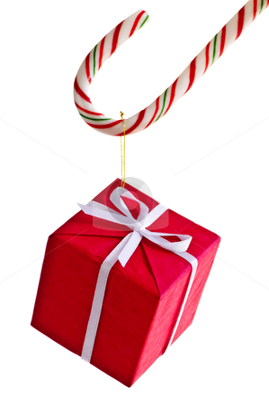 Candy cane and present stock photo, Closeup of striped candy cane with gift box isolated on white by Elena Elisseeva