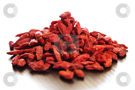 Goji berries stock photo, Loose pile of red dried goji berries by Elena Elisseeva