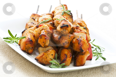 Chicken skewers stock photo, Pile of barbecued chicken kebab appetizers on a plate by Elena Elisseeva