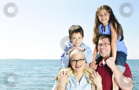 Happy family fun stock photo, Happy family having fun giving shoulder rides by Elena Elisseeva