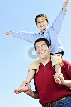 Father and son stock photo, Portrait of father giving shoulder ride to son by Elena Elisseeva