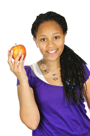 Girl holding apple stock photo, Isolated portrait of black teenage girl holding apple by Elena Elisseeva