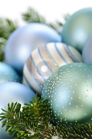 Christmas ornaments stock photo, Many Christmas decorations laying in pine branches by Elena Elisseeva