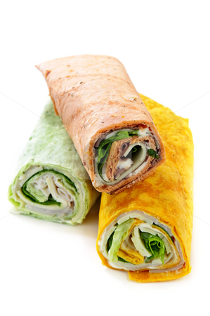 Wrap sandwiches stock photo, Three isolated multicolored tortilla wraps with meat and vegetables by Elena Elisseeva