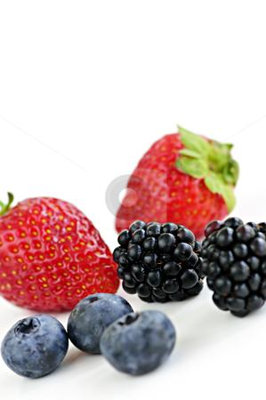 Assorted fresh berries stock photo, Closeup of assorted fresh berries isolated on white background by Elena Elisseeva
