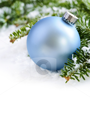 Christmas ornament stock photo, Blue Christmas decoration in snow with pine branches by Elena Elisseeva
