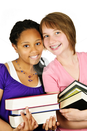 Girls holding text books stock photo, Isolated portrait of two teenage girls holding text books by Elena Elisseeva