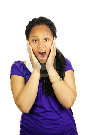 Teenage girl surprised stock photo, Isolated portrait of surprised black teenage girl by Elena Elisseeva