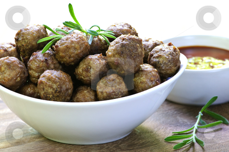 Meatballs and sauce stock photo, Fresh hot meatball appetizers served in white bowl with dipping sauce by Elena Elisseeva