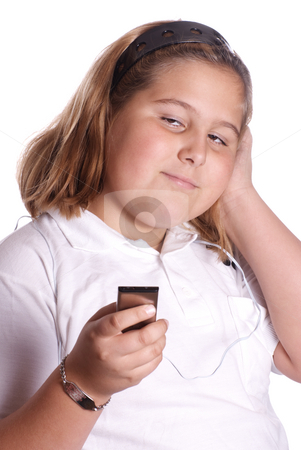 Listening To Music stock photo, A young girl listening to her MP3 player isolated against a white background by Richard Nelson
