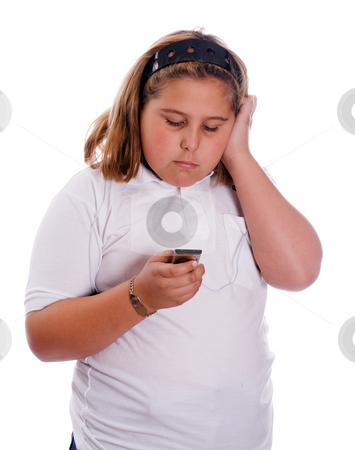 Listening To MP3 Player stock photo, A young girl listening to her MP3 player isolated against a white background by Richard Nelson