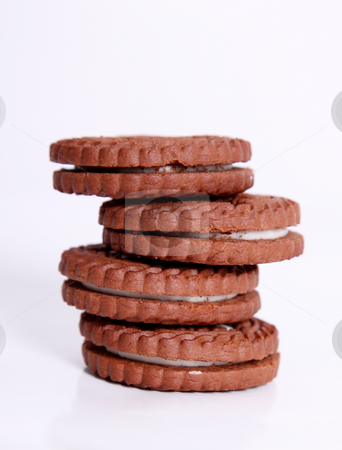 Cookies stock photo, Four chocolate cookies on a white tower by Giuseppe Ramos