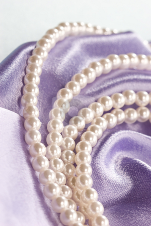 Pearl stock photo, Beads of pearl on the lilac for lady by Gennady Kravetsky