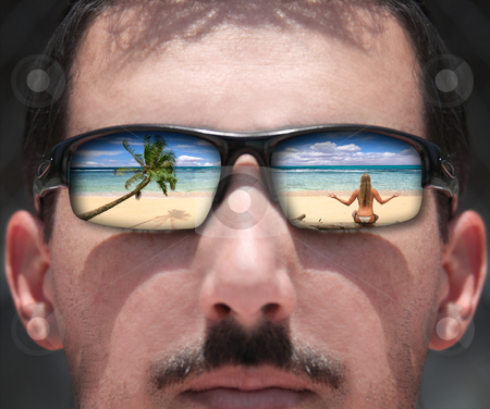 Man Looking at a Woman on the Beach Through Sunglasses stock photo, Man Looking at a Woman on the Beach Through Sunglasses by Katrina Brown