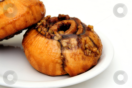 Sticky Bun stock photo, Cinnamon sticky buns on a white plate isolated on a white background by Lynn Bendickson
