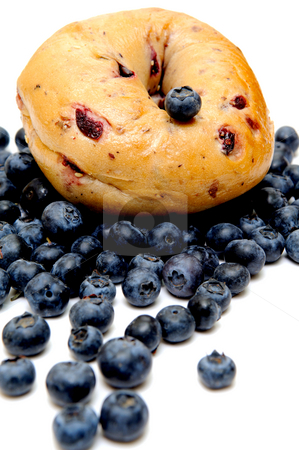 Blueberry Bagel stock photo, Fresh Blueberries on an isolated white background topped with a berry bagel by Lynn Bendickson