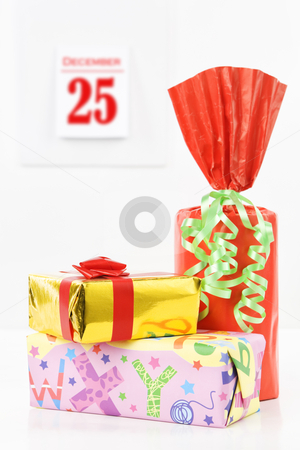 Gifts on christmas stock photo, Gifts on christmas with the calendar on background by Rudyanto Wijaya